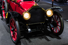 Antique red American automobile car Stock Images