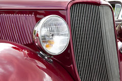 Antique Red Car. A retro red muscle car Royalty Free Stock Photo