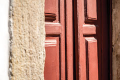 Antique red door on the city of Ouro Preto, Minas Gerais, Brazil Royalty Free Stock Photos