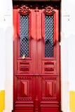 Antique Red door in Mertola, Portugal. Stock Image