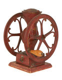 Antique red iron tabletop wheel coffee grinder Royalty Free Stock Photo