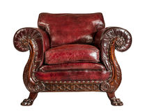 Antique red leather arm chair carved legs isolated. Old comfortable antique red leather arm chair stock photo