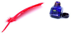 Antique red pen and inkwell Stock Image