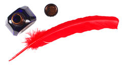 Antique red pen and inkwell Stock Photo
