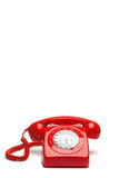 Antique red phone. On a white background Stock Photography