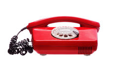 Antique red phone on a white Royalty Free Stock Photography