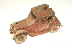 Antique Red Toy Car. Photo of an antique red toy car royalty free stock image
