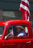 Antique Red Truck and cowboy drive in July 4, Independence Day Parade, Telluride, Colorado, USA Stock Photography