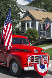 Antique Red Truck and US Flag, July 4, Independence Day Parade, Telluride, Colorado, USA Royalty Free Stock Images