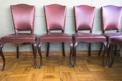 Antique red upholstered chairs royalty free stock photography