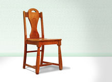 Antique Red Wood Chair Against A Green Wall Royalty Free Stock Image