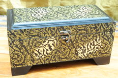 Antique replica jewelery box. A replica of an antique jewelery box, made of wood with copper inlays royalty free stock image