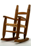 Antique Reproduction Toy Rocking Chair. Antique reproduction of miniature scale model toy wood rocking chair over white Stock Image