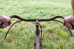 Antique or retro bicycle handlebar outside Stock Images