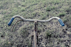 Antique or retro bicycle handlebar outside Stock Image