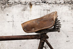 Antique or retro bicycle leather saddle Royalty Free Stock Images