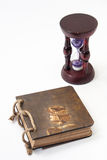 Antique retro diary bound with rope and hourglass with golden ri Stock Photo