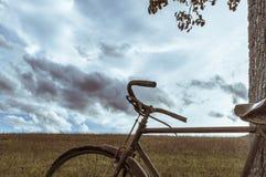 Antique or retro oxidized bicycle outside Stock Photos