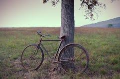 Antique or retro oxidized bicycle outside Royalty Free Stock Photos