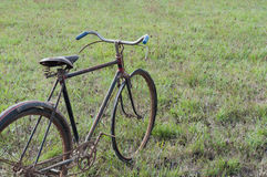 Antique or retro oxidized bicycle outside Stock Photo