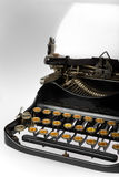 Antique Retro Typewriter. Close-up of vintage retro typewriter with blank sheet of paper royalty free stock photography