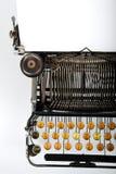 Antique Retro Typewriter. Close-up of vintage retro typewriter with blank sheet of paper stock photos