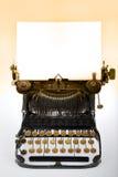 Antique Retro Typewriter. Vintage retro typewriter with blank white sheet on gradient background Stock Images