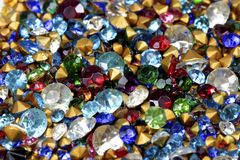 Antique Rhinestones. Extreme closeup of loose antique rhinestones in a variety of colors and sizes Stock Image