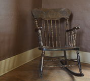 Antique Rocking Chair. In corner stock photography