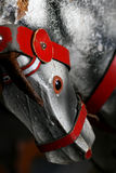 Antique Rocking Horse. Macro of antique Rocking Horse with Red Harness royalty free stock photography