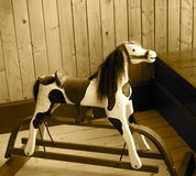 Antique Rocking Horse In Sepia Tone Royalty Free Stock Photos