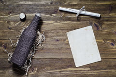 Antique rolled message and old bottle. Royalty Free Stock Image