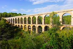 Antique roman aqueduct in  forest. Tarragona. Catalonia Royalty Free Stock Photo