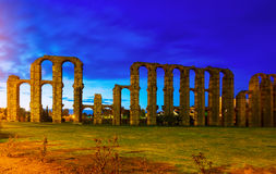 Antique  Roman Aqueduct of Merida in evening. Lights. Extremadura, Spain Stock Photography