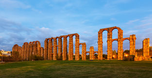 Antique  Roman Aqueduct of Merida in  twilight. Lights. Extremadura, Spain Royalty Free Stock Photo