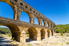 Antique Roman aqueduct Pont du Gard, France. Pont du Gard - the highest-preserved ancient Roman aqueduct. Thrown over the Gardon River in the French department Stock Images
