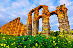 Antique  roman aqueduct. Wide angle shot of antique  roman aqueduct in  evening lights. Merida, Spain Stock Photography