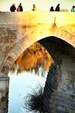 Antique roman bridge in Cordoba. Cordoba, Spain- December 30, 2018: Beautiful antique roman bridge over the Guadalquivir river at sunset in Cordoba , Spain royalty free stock images
