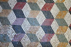 Antique roman floor mosaic with geometrical pattern. With white, blue, red, yellow and gray tiles royalty free stock image