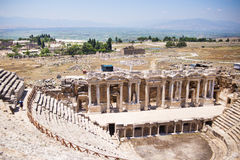 Antique Roman Hierapolis. Roman Hierapolis with adjacent remains of buildings, Pamukkale, Turkey.Ruins of theater Stock Images