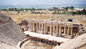 Antique Roman Hierapolis. Roman Hierapolis with adjacent remains of buildings, Pamukkale, Turkey.Ruins of theater Royalty Free Stock Photos
