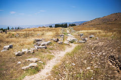 Antique Roman Hierapolis. Roman Hierapolis with adjacent remains of buildings, Pamukkale, Turkey. UNESCO World Heritage Stock Image