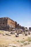 Antique Roman Hierapolis. Roman Hierapolis with adjacent remains of buildings, Pamukkale, Turkey. UNESCO World Heritage Stock Images