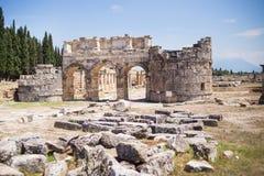 Antique Roman Hierapolis. Roman Hierapolis with adjacent remains of buildings, Pamukkale, Turkey. UNESCO World Heritage Stock Photo