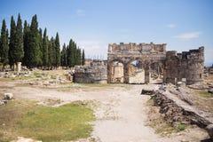 Antique Roman Hierapolis. Roman Hierapolis with adjacent remains of buildings, Pamukkale, Turkey. UNESCO World Heritage Royalty Free Stock Photos
