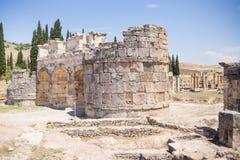 Antique Roman Hierapolis. Roman Hierapolis with adjacent remains of buildings, Pamukkale, Turkey. UNESCO World Heritage Royalty Free Stock Photo