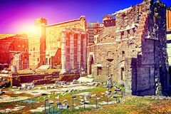 Antique Roman ruins in Rome and blue sky, Italy Stock Photography