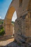 Antique roman stone bridge over Cardener river Stock Photos