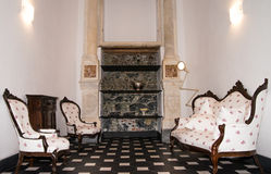 Antique room with armchairs Stock Photos