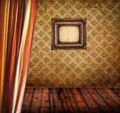 Antique room with curtain wooden floor and empty golden frame Stock Images